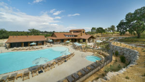 Cava Robles RV Resort swimming pool and clubhouse in Paso Robles, CA