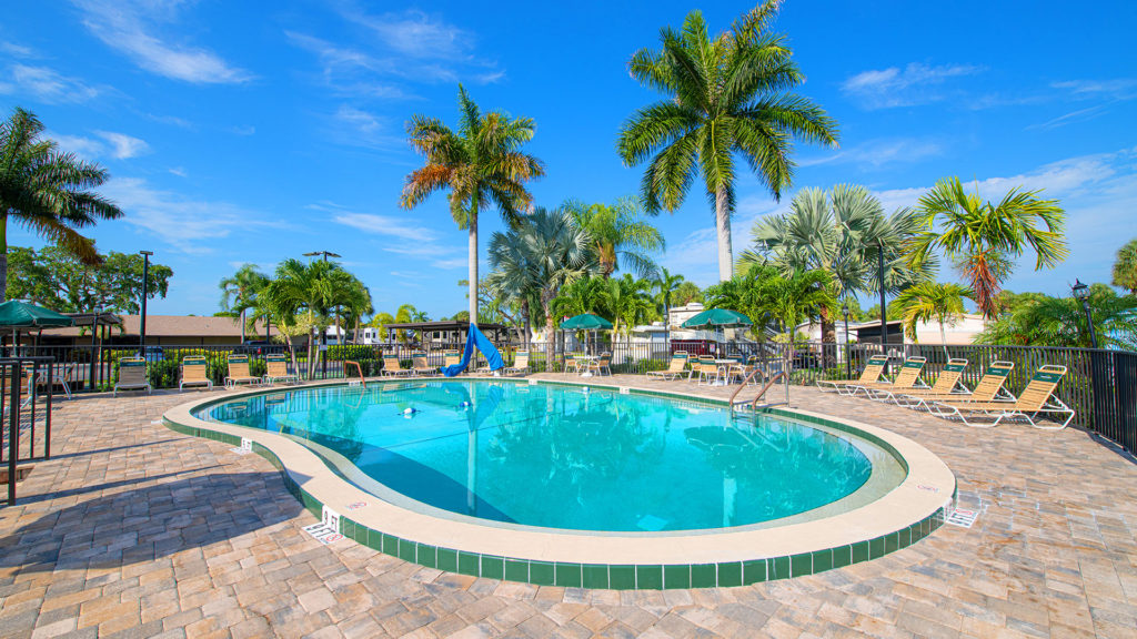 Groves RV Resort, Vacation Rentals and Manufactured Homes Community Swimming Pool in Ft. Myers, FL