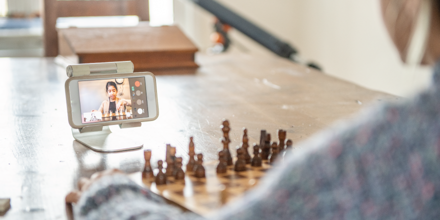 Person Playing Chess Over Video Call