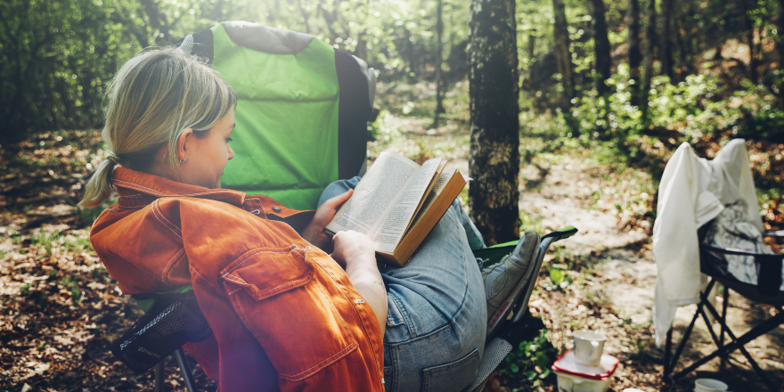 Woman Reading Book While Camping